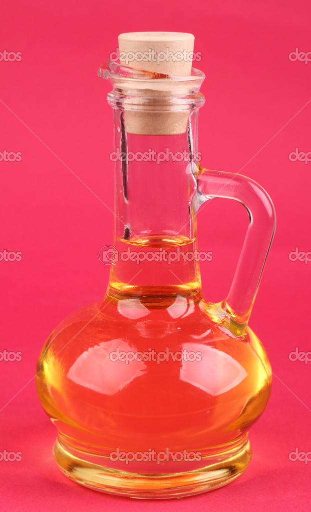 Image of glass jug with oil over bright background on Food theme — Stock Photo #10151677