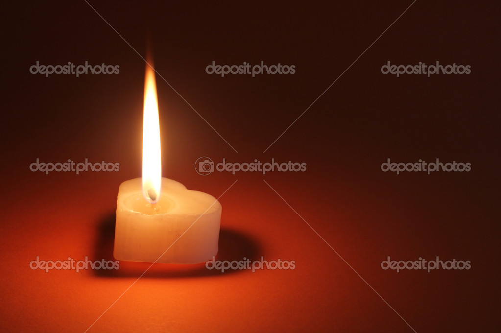 Image of heart shaped single candle over dark background — Stok fotoğraf #10151705