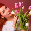 Lovely girl with tulips — Stock Photo