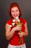 Pretty girl with white tulips — Stock Photo