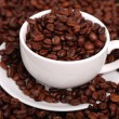 Single white coffee cup over coffee background on coffee beans background — Stock Photo