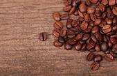 Coffee beans on wooden background — Foto Stock