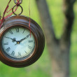 Hanging round clocks outdoor — Stok Fotoğraf #10450344