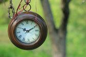 Hanging round clocks outdoor — Stock Photo