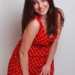 Young woman in red — Stock Photo