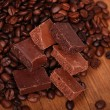 Some chocolate and coffee beans - Stock Photo