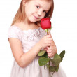 Little girl with red rose — Stock Photo