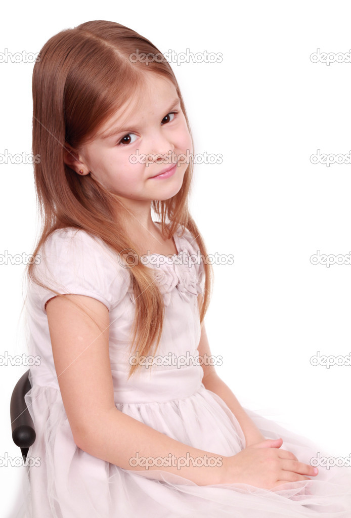 Happy smiling little girl on white background in studio  Stock Photo #8985401
