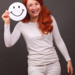 Smiling girl with red hair — Stock Photo