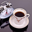 Cup of coffee and watch on the table - Stock Photo
