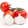 A lot of tomatoes and garlic — Stock Photo