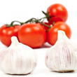 A lot of tomatoes and garlic — Stock Photo #10286158