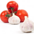 A lot of tomatoes and garlic — Stock Photo #10286178
