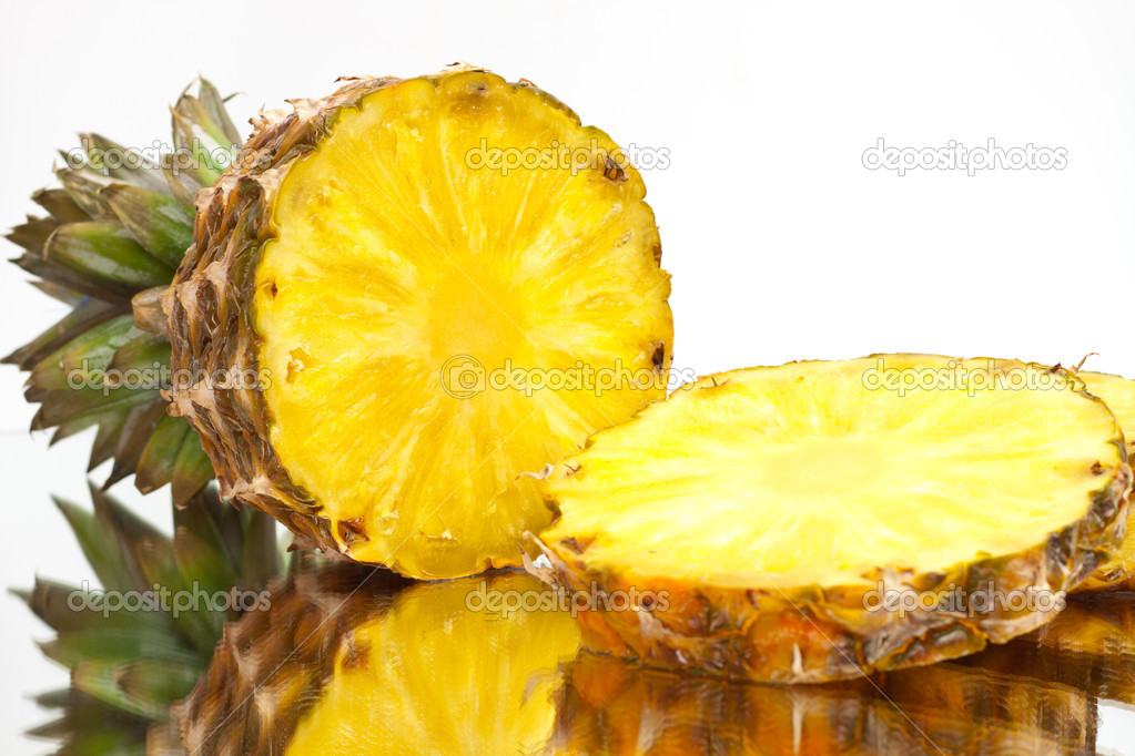 Ripe pineapple sliced ​​on a light background — Stock Photo #10348398