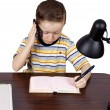 A little boy thinks the headphones with microphone — Stock Photo #9648135