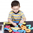 A little boy learns the numbers — Stock Photo #9676190