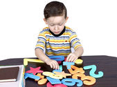 A little boy learns the numbers — Stock Photo