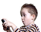 The boy was surprised to look in the phone — Stock Photo