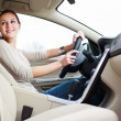 Stock Photo: Woman driving a car