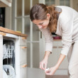 Housework: young woman putting dishes in the dishwasher — Φωτογραφία Αρχείου