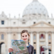 Pretty young female tourist studying a map — Stock Photo #10408552