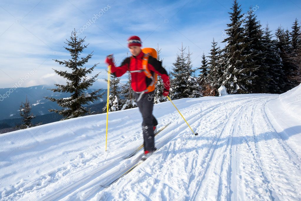 Cross-country skiing: young man cross-country skiing on a lovely sunny winter day — Stock Photo #10408377
