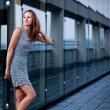 Young woman posing inside a modern top architecture building — Stock Photo #7998253