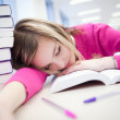 In the library - very tired/exhausted, pretty, female student — Stock Photo #7998641