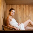 Young woman relaxing in a sauna — Stock Photo