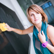 College student/young teacher writing on the chalkboard — Stock Photo
