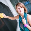 College student/young teacher writing on the chalkboard — Stock Photo #8173921