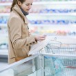 Pretty youman buying groceries in a supermarket — Stock Photo #8279970