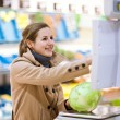 Beautiful young woman shopping for fruits and vegetables — Stock Photo #8279976