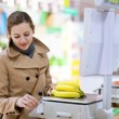 Beautiful young woman shopping for fruits and vegetables — Stock Photo #8280026