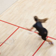 Two female squash players in fast action on a squash court — Stock Photo