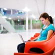 Pretty young female student with laptop — Stock Photo