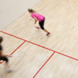 Two female squash players in fast action on a squash court — Stock Photo #8280136