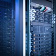 Server rack cluster in a data center — Stock Photo #8520658