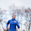 Portrait of a woman running against against blue sky — Stock Photo #8520737