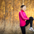 Young woman stretching before her run — Stock Photo