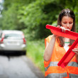 Young female driver after her car has broken down - Stockfoto