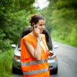 Young female driver calling the roadside service — Stock Photo