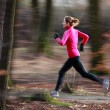 Young woman running outdoors in a city park on a cold fall — Stock Photo #8520854