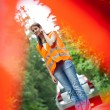 Young female driver calling the roadside service — Stock Photo #8520894