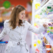 Beautiful young woman shopping in supermarket — Stock Photo #8520954