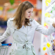 Beautiful young woman shopping in supermarket — Stock Photo #8520958
