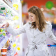 Beautiful young woman shopping in supermarket — Stock Photo #8520962
