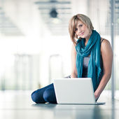 Pretty young female student with a laptop computer — Stock Photo