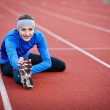 Young woman stretching before her run — Stock Photo #8666215