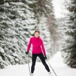 Cross-country skiing: young woman cross-country skiing — Stock Photo #8666217